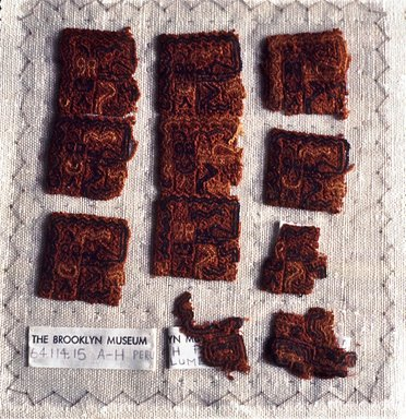 Paracas Necropolis. <em>8 Textile Fragments, Unascertainable or Mantle Border Fragments</em>, 800 B.C.E.-600 C.E. Cotton, camelid fiber, Largest fragment: 1 9/16 x 1 3/16in. (4 x 3cm). Brooklyn Museum, Gift of Adelaide Goan, 64.114.15a-h (Photo: Brooklyn Museum, CUR.64.114.15a-h.jpg)