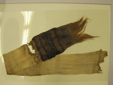Chimú. <em>Loincloth, Tie, Fragment</em>, 1000-1700. Cotton, camelid fiber, opened: 27 15/16 x 7 1/16 in. (71.0 x 18.0 cm). Brooklyn Museum, Gift of Adelaide Goan, 64.114.191 (Photo: Brooklyn Museum, CUR.64.114.191-1.jpg)