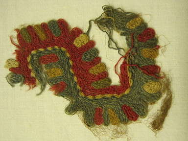 <em>Textile Fragment, undetermined</em>. Camelid fiber, 2 15/16 x 2 3/8 in. (7.5 x 6 cm). Brooklyn Museum, Gift of Adelaide Goan, 64.114.207 (Photo: , CUR.64.114.207.jpg)