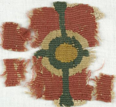 Coptic. <em>Rosette Fragment</em>, 5th-7th century C.E. Linen, wool, 3 3/4 x 4 in. (9.5 x 10.2 cm). Brooklyn Museum, Gift of Adelaide Goan, 64.114.244 (Photo: Brooklyn Museum (in collaboration with Index of Christian Art, Princeton University), CUR.64.114.244_ICA.jpg)