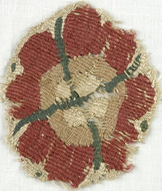 Coptic. <em>Rosette Fragment</em>, 5th-7th century C.E. Flax, wool, 3 1/4 x 4 1/4 in. (8.3 x 10.8 cm). Brooklyn Museum, Gift of Adelaide Goan, 64.114.245 (Photo: Brooklyn Museum (in collaboration with Index of Christian Art, Princeton University), CUR.64.114.245_ICA.jpg)