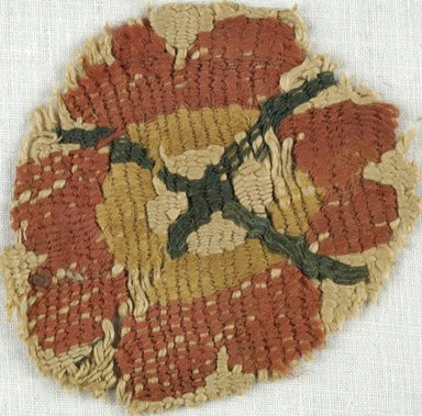 Coptic. <em>Rosette Fragment</em>, 5th-7th century C.E. Flax, wool, 2 1/2 in. Diam. (6.4 cm). Brooklyn Museum, Gift of Adelaide Goan, 64.114.246 (Photo: Brooklyn Museum (in collaboration with Index of Christian Art, Princeton University), CUR.64.114.246_ICA.jpg)