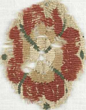 Coptic. <em>Rosette Fragment</em>, 5th-7th century C.E. Flax, wool, 3 x 4 in. (7.6 x 10.2 cm). Brooklyn Museum, Gift of Adelaide Goan, 64.114.247 (Photo: Brooklyn Museum (in collaboration with Index of Christian Art, Princeton University), CUR.64.114.247_ICA.jpg)
