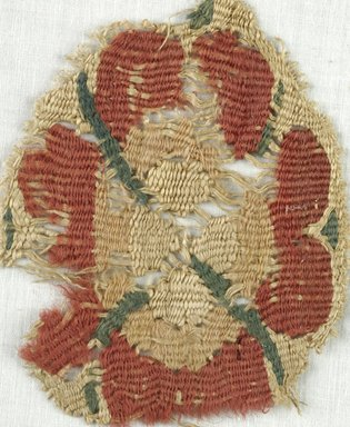 Coptic. <em>Rosette Fragment</em>, 5th-7th century C.E. Flax, wool, 3 1/4 x 4 1/4 in. (8.3 x 10.8 cm). Brooklyn Museum, Gift of Adelaide Goan, 64.114.248 (Photo: Brooklyn Museum (in collaboration with Index of Christian Art, Princeton University), CUR.64.114.248_ICA.jpg)
