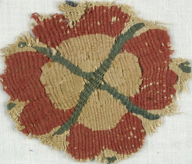 Coptic. <em>Rosette Fragment</em>, 5th-7th century C.E. Flax, wool, 3 x 3 1/2 in. (7.6 x 8.9 cm). Brooklyn Museum, Gift of Adelaide Goan, 64.114.250 (Photo: Brooklyn Museum (in collaboration with Index of Christian Art, Princeton University), CUR.64.114.250_ICA.jpg)