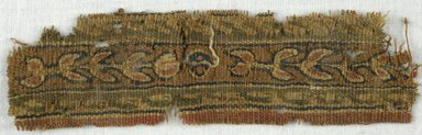 Coptic. <em>Band Fragment with Botanical Decoration</em>, 5th-7th century C.E. Wool, 1 3/8 x 5 1/2 in. (3.5 x 14 cm). Brooklyn Museum, Gift of Adelaide Goan, 64.114.261 (Photo: Brooklyn Museum (in collaboration with Index of Christian Art, Princeton University), CUR.64.114.261_ICA.jpg)