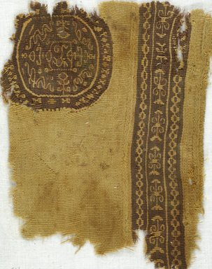 Coptic. <em>Band Fragment and Roundel with Botanical and Geometric Decoration</em>, 5th-7th century C.E. Wool, 6 1/4 x 7 3/4 in. (15.9 x 19.7 cm). Brooklyn Museum, Gift of Adelaide Goan, 64.114.268 (Photo: Brooklyn Museum (in collaboration with Index of Christian Art, Princeton University), CUR.64.114.268_ICA.jpg)