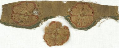 Coptic. <em>Fragment with Botanical Decoration</em>, 5th-7th century C.E. Wool, linen, 64.114.269a: 2 5/8 × 11 in. (6.6 × 28 cm). Brooklyn Museum, Gift of Adelaide Goan, 64.114.269 (Photo: Brooklyn Museum (in collaboration with Index of Christian Art, Princeton University), CUR.64.114.269_ICA.jpg)