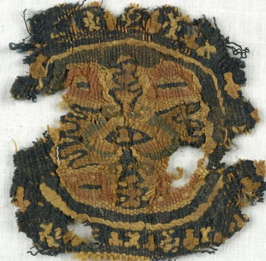 Coptic. <em>Roundel Fragment with Botanical Decoration</em>, 5th-7th century C.E. Wool, 3 1/8 x 3 1/8 in. (8 x 8 cm). Brooklyn Museum, Gift of Adelaide Goan, 64.114.278 (Photo: Brooklyn Museum (in collaboration with Index of Christian Art, Princeton University), CUR.64.114.278_ICA.jpg)