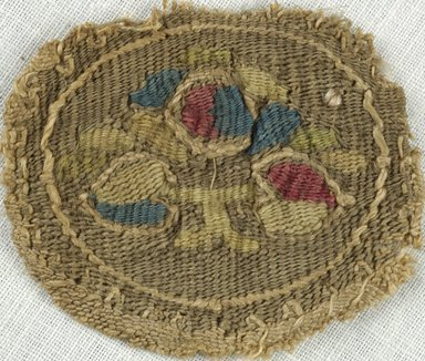 Coptic. <em>Roundel with Botanical Decoration</em>, 5th-7th century C.E. Flax, wool, 1 9/16 x 1 9/16 in. (4 x 4 cm). Brooklyn Museum, Gift of Adelaide Goan, 64.114.279 (Photo: Brooklyn Museum (in collaboration with Index of Christian Art, Princeton University), CUR.64.114.279_ICA.jpg)
