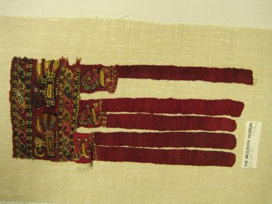 Chimú. <em>Textile Fragment, Undetermined or Textile Fragment, Undetermined, Border Fringe</em>, 1000-1532. Cotton, camelid fiber, 10 3/4 × 4 1/2 in. (27.3 × 11.4 cm). Brooklyn Museum, Gift of Adelaide Goan, 64.114.71 (Photo: Brooklyn Museum, CUR.64.114.71.jpg)