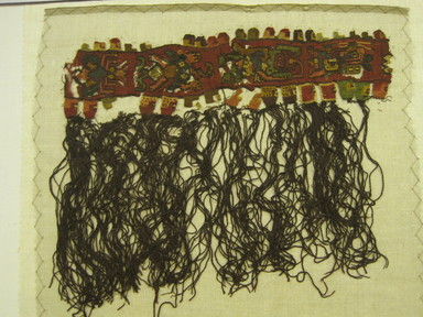 Proto-Nazca (curvilinear). <em>Textile Fragment, Unascertainable or possible Border</em>, 200-600 C.E. Cotton, camelid fiber, 9 1/4 × 10 1/2 in. (23.5 × 26.7 cm). Brooklyn Museum, Gift of Adelaide Goan, 64.114.72 (Photo: , CUR.64.114.72-1.jpg)