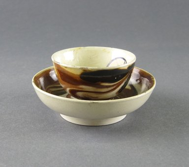 Attributed to Thomas Whieldon (1719-1795). <em>Miniature Tea Cup and Saucer</em>, ca. 1750. Earthenware, Marbleized ware, Cup: 1 1/16 x 1 7/8 in. (2.7 x 4.8 cm). Brooklyn Museum, Gift of the Estate of Emily Winthrop Miles, 64.195.14a-b. Creative Commons-BY (Photo: Brooklyn Museum, CUR.64.195.14a-b_view2.jpg)