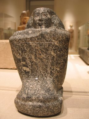 Egyptian. <em>Temple Block Statue of a Man Connected to the Estate of a God's Wife of Amun</em>, ca. 775-653 B.C.E. Diorite, 9 3/16 x 5 5/16 x 6 5/16 in. (23.4 x 13.5 x 16 cm). Brooklyn Museum, Charles Edwin Wilbour Fund, 64.200.1. Creative Commons-BY (Photo: Brooklyn Museum, CUR.64.200.1_wwgA-2.jpg)
