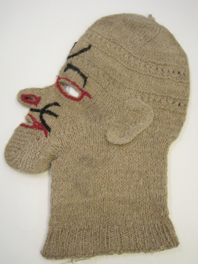Quechua. <em>Knitted Mask</em>, 20th century. Camelid fiber? wool?, 9 1/4 × 1/4 × 13 1/8 in. (23.5 × 0.6 × 33.3 cm). Brooklyn Museum, Gift of Dr. Werner Muensterberger, 64.210.15. Creative Commons-BY (Photo: , CUR.64.210.15.jpg)