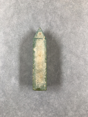 <em>Obelisk</em>, ca. 1075-332 B.C.E. Glass, 2 5/16 × 11/16 × 11/16 in. (5.9 × 1.8 × 1.8 cm). Brooklyn Museum, Charles Edwin Wilbour Fund, 65.134.2. Creative Commons-BY (Photo: , CUR.65.134.2_view01.jpg)