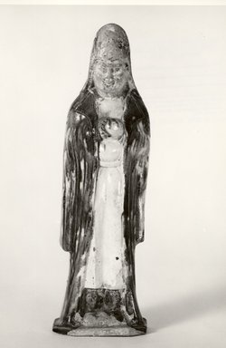 <em>Grave Figurine of an Official or Priest</em>, 8th-9th century. Ceramic, 10 13/16 x 3 1/16 x 2 9/16 in. (27.5 x 7.8 x 6.5 cm). Brooklyn Museum, Gift of Laurice M. Khouri in memory of her father, Alexander N. Khouri, 65.147. Creative Commons-BY (Photo: Brooklyn Museum, CUR.65.147_bw.jpg)