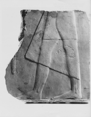 <em>Fragment of a Relief</em>, 664-332 B.C.E. Limestone, 6 15/16 x 6 5/16 x 11/16 in. (17.7 x 16 x 1.8 cm). Brooklyn Museum, Anonymous gift, 65.194.1. Creative Commons-BY (Photo: , CUR.65.194.1_NegA_print_bw.jpg)