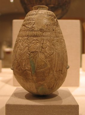Egyptian. <em>Relief-Decorated Ovoid Bottle</em>, ca. 945 B.C.E.-718 B.C.E. Faience, 4 7/16 x 2 3/4 in. (11.2 x 7 cm). Brooklyn Museum, Charles Edwin Wilbour Fund, 65.2.2a-b. Creative Commons-BY (Photo: Brooklyn Museum, CUR.65.2.2a-b_wwg8.jpg)