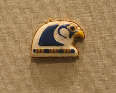 <em>Terminal from a Broad Collar</em>, 305-30 B.C.E. Gold, glass, 1 3/8 x 1 3/4 x 1/4 in. (3.5 x 4.5 x 0.7 cm). Brooklyn Museum, Charles Edwin Wilbour Fund, 65.3.2. Creative Commons-BY (Photo: Brooklyn Museum, CUR.65.3.2_wwg8.jpg)