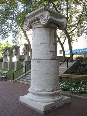 Charles Follen McKim. <em>Partial Column, from Penn Station, 31st to 33rd Streets between 7th and 8th Avenues, NYC (demolished 1964)</em>, ca. 1910. Travertine marble, 145 x 136 in. (368.3 x 345.4 cm). Brooklyn Museum, Gift of Lipsett Incorported, 66.250.2. Creative Commons-BY (Photo: Brooklyn Museum, CUR.66.250.2.jpg)