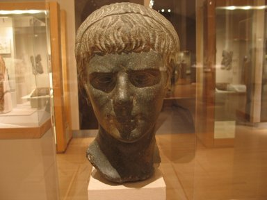 Roman. <em>Portrait Head of Young Man</em>, 10 B.C.E.-20. C.E. Schist or graywacke, 13 13/16 x 8 1/8 x 8 7/16 in., 44 lb. (35.1 x 20.6 x 21.5 cm, 19.96kg). Brooklyn Museum, Charles Edwin Wilbour Fund, 66.65. Creative Commons-BY (Photo: Brooklyn Museum, CUR.66.65_wwg8_2014.jpg)