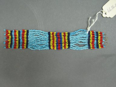 Possibly Zulu. <em>Ankle or Wrist Cuffs</em>, mid-20th century. Glass seed beads, natural fiber, a: 6 1/2 x 1 1/2 in. (16.5 x 3.8 cm). Brooklyn Museum, Gift of Mr. and Mrs. Jerome Blum, 66.86.10a-d. Creative Commons-BY (Photo: Brooklyn Museum, CUR.66.86.10b_overall.jpg)