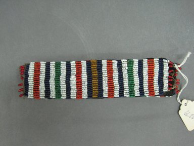 Possibly Zulu. <em>Pair of Cuffs</em>, early 20th century. Woven beadwork, 6 3/4 x 1/2 in. (17.1 x 1.3 cm). Brooklyn Museum, Gift of Mr. and Mrs. Jerome Blum, 66.86.12a-b. Creative Commons-BY (Photo: Brooklyn Museum, CUR.66.86.12a-b_overall.jpg)