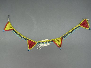 Possibly Zulu. <em>Neck Ornament</em>, mid-20th century. Glass seed beads, natural fiber, 16 x 1 3/4 in. (40.6 x 4.4 cm). Brooklyn Museum, Gift of Mr. and Mrs. Jerome Blum, 66.86.18. Creative Commons-BY (Photo: Brooklyn Museum, CUR.66.86.18_overall.jpg)