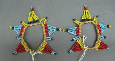 Zulu. <em>Small Body Ornaments</em>, early 20th century. Glass beads, natural fiber, diam: 1 5/8in (4.1cm). Brooklyn Museum, Gift of Mr. and Mrs. Jerome Blum, 66.86.21a-b. Creative Commons-BY (Photo: Brooklyn Museum, CUR.66.86.21a-b_overall.jpg)