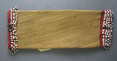 Zulu. <em>Bag or Spoon Holder (ipontshi)</em>, early 20th century. natural fiber, cotton thread, glass beads, 10 1/8 x 3 3/4 in. (25.7 x 9.5 cm). Brooklyn Museum, Gift of Mr. and Mrs. Jerome Blum, 66.86.23. Creative Commons-BY (Photo: , CUR.66.86.23_overall.jpg)
