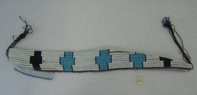 Possibly Zulu. <em>Girdle with Apron</em>, mid 20th century, 1930-1950. Glass beads, natural fiber, cloth, sinew, 34 5/8 x 4in. (87.9 x 10.2cm). Brooklyn Museum, Gift of Mr. and Mrs. Jerome Blum, 66.86.2. Creative Commons-BY (Photo: Brooklyn Museum, CUR.66.86.2_overall.jpg)