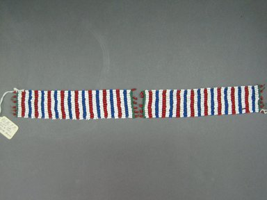 Possibly Zulu. <em>Cuffs for Ankle or Wrist</em>, mid-to-late 20th century. Glass seed beads, natural fiber, 7 1/4 x 1 5/8 in. (18.4 x 4.1 cm). Brooklyn Museum, Gift of Mr. and Mrs. Jerome Blum, 66.86.8a-b. Creative Commons-BY (Photo: Brooklyn Museum, CUR.66.86.8a-b_overall.jpg)