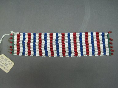 Possibly Zulu. <em>Cuffs for Ankle or Wrist</em>, early 20th century. Glass seed beads, natural fiber, 6 x 5/8 in. (15.2 x 1.6 cm). Brooklyn Museum, Gift of Mr. and Mrs. Jerome Blum, 66.86.9a-b. Creative Commons-BY (Photo: Brooklyn Museum, CUR.66.86.8b_overall.jpg)
