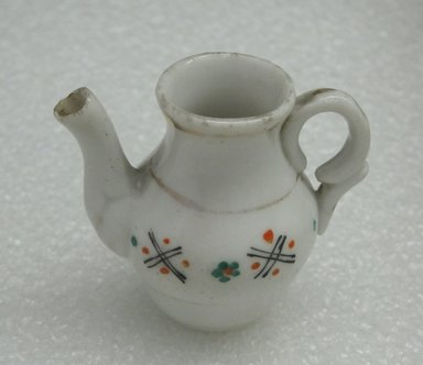 <em>Miniature Chocolate Pot and Cover</em>, ca 1920. Decorated porcelain, 2 3/8 x 1 1/4 in. (6 x 3.2 cm). Brooklyn Museum, Bequest of Laura L. Barnes, 67.120.167a-b. Creative Commons-BY (Photo: Brooklyn Museum, CUR.67.120.167a_view2.jpg)