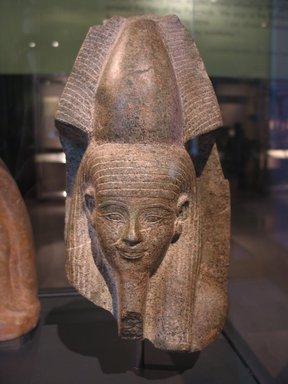 <em>Head of a God</em>, ca. 1390-1353 B.C.E. Metamorphic stone, 10 3/16 x 5 1/2 x 4 13/16 in. (25.9 x 14 x 12.2 cm). Brooklyn Museum, Charles Edwin Wilbour Fund, 67.14. Creative Commons-BY (Photo: Brooklyn Museum, CUR.67.14_erg456.jpg)