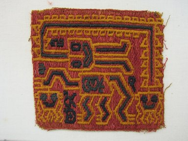Paracas Necropolis. <em>Textile Fragment, unascertainable or possible Mantle, Fragment</em>, 200-600. Cotton, camelid fiber, 3 9/16 × 3 1/8 in. (9 × 8 cm). Brooklyn Museum, Gift of Adelaide Goan, 67.159.11. Creative Commons-BY (Photo: Brooklyn Museum, CUR.67.159.11.jpg)