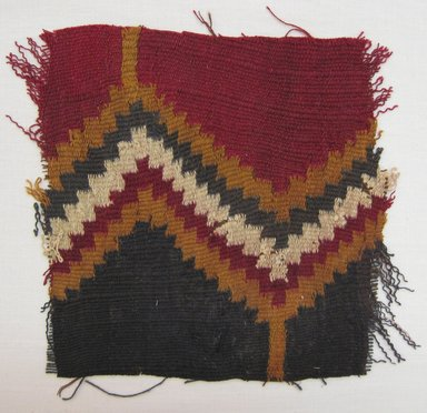 Coastal Wari. <em>Textile Fragment, unascertainable or possible Tunic, Fragment</em>, 600-1000 C.E. Cotton, camelid fiber, 7 × 7 in. (17.8 × 17.8 cm). Brooklyn Museum, Gift of Adelaide Goan, 67.159.25. Creative Commons-BY (Photo: Brooklyn Museum, CUR.67.159.25.jpg)