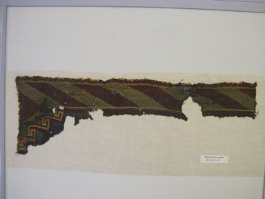 (Post) Middle Horizon (Range attributed by Nobuko Kajitani, 1993). <em>possible Mantle, Fragment</em>, Undetermined or 1000-1400. Cotton, 7 3/4 × 23 7/16 in. (19.7 × 59.5 cm). Brooklyn Museum, Gift of Adelaide Goan, 67.159.41. Creative Commons-BY (Photo: , CUR.67.159.41.jpg)