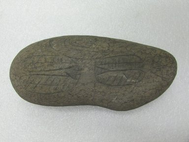 Rapanui. <em>Stone Pillow</em>. Basalt, 3 3/8 x 7 5/8in. (8.5 x 19.3cm). Brooklyn Museum, Gift of Joanna Bergvall, 67.183. Creative Commons-BY (Photo: Brooklyn Museum, CUR.67.183_view1.jpg)