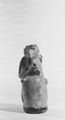 <em>Ape Holding a Vessel</em>, 7th-6th century B.C.E. Faience, 3 11/16 x 1 9/16 x 2 5/16 in. (9.3 x 4 x 5.8 cm). Brooklyn Museum, Charles Edwin Wilbour Fund, 67.1. Creative Commons-BY (Photo: Brooklyn Museum, CUR.67.1_NegA_print_bw.jpg)