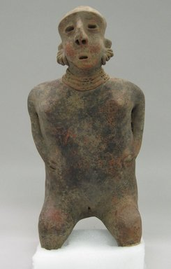 Nayarit. <em>Large Female Figure</em>, ca. 300 B.C.E.-400 C.E. Ceramic, 15 x 7 x 5 1/2 in. (38.1 x 17.8 x 14 cm). Brooklyn Museum, Gift of Mr. and Mrs. Marvin Cassell, 67.206.18. Creative Commons-BY (Photo: Brooklyn Museum, CUR.67.206.18_front.jpg)