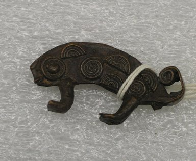 Akan. <em>Gold-weight (abrammuo): animal</em>., 7/8 x 1 7/8 x 3/8 in. (2.2 x 4.8 x 1 cm). Brooklyn Museum, Bequest of Laura L. Barnes, 67.25.17. Creative Commons-BY (Photo: Brooklyn Museum, CUR.67.25.17.jpg)
