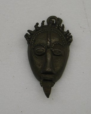 Akan. <em>Mask</em>., 1 5/8 x 1 x 3/8 in. (4.2 x 2.5 x 1 cm). Brooklyn Museum, Bequest of Laura L. Barnes, 67.25.5. Creative Commons-BY (Photo: Brooklyn Museum, CUR.67.25.5.jpg)
