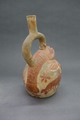 Moche. <em>Stirrup-Spout Vessel with Lobster</em>, 400-500. Ceramic, cream and red slips, 9 1/4 x 5 x 7 1/4 in. (23.5 x 12.7 x 18.4 cm). Brooklyn Museum, Gift of Robert L. Niles, 67.86.1. Creative Commons-BY (Photo: , CUR.67.86.1_view05.jpg)
