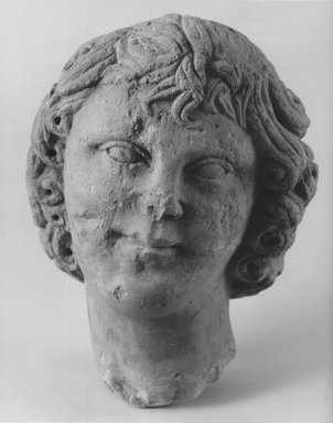 <em>Head of a Youth</em>. Limestone, 10 1/16 x 7 7/8 x 7 1/2 in. (25.6 x 20 x 19 cm). Brooklyn Museum, Charles Edwin Wilbour Fund, 68.151. Creative Commons-BY (Photo: Brooklyn Museum, CUR.68.151_NegA_print.bw.jpg)