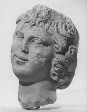 <em>Head of a Youth</em>. Limestone, 10 1/16 x 7 7/8 x 7 1/2 in. (25.6 x 20 x 19 cm). Brooklyn Museum, Charles Edwin Wilbour Fund, 68.151. Creative Commons-BY (Photo: Brooklyn Museum, CUR.68.151_NegB_print.bw.jpg)