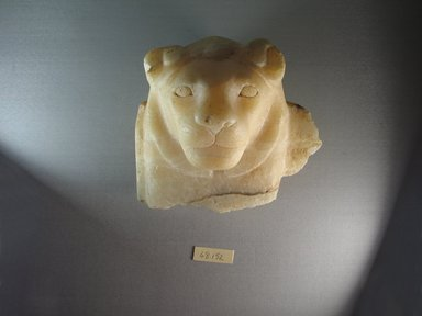 <em>Lion's Head</em>. Egyptian alabaster (calcite), 6 1/2 x 7 3/8 x 5 5/16 in. (16.5 x 18.7 x 13.5 cm). Brooklyn Museum, Charles Edwin Wilbour Fund, 68.152. Creative Commons-BY (Photo: Brooklyn Museum, CUR.68.152_view1.jpg)