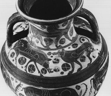 Attributed to Wolfshead Painter. <em>Italo-Corinthian Amphora</em>, 6th century B.C.E. Clay, slip, Height: (35.6 cm). Brooklyn Museum, Gift of Christos G. Bastis, 69.111. Creative Commons-BY (Photo: Brooklyn Museum, CUR.69.111_NegE_print_bw.jpg)