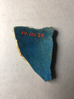 <em>Vessel Fragment</em>, 305 B.C.E.-395 C.E. Faience, 2 3/4 x 1 15/16 x 5/16 in. (7 x 5 x 0.8 cm). Brooklyn Museum, Anonymous gift, 69.112.33. Creative Commons-BY (Photo: , CUR.69.112.33_view02.jpg)